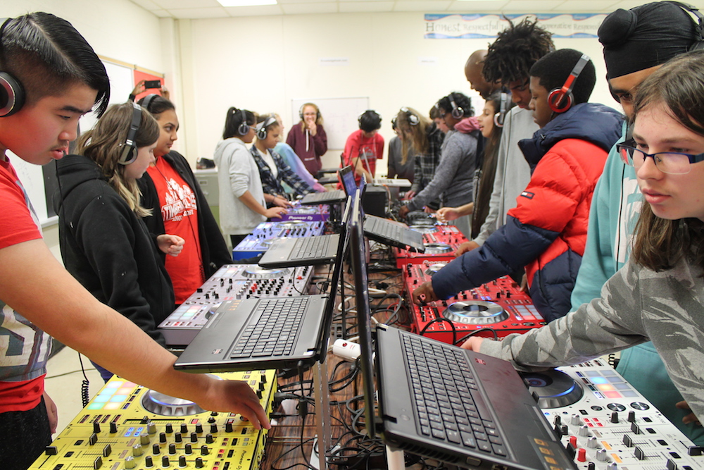 Students learn integers, percentages, decimals, division, multiplication from a DJ console.
