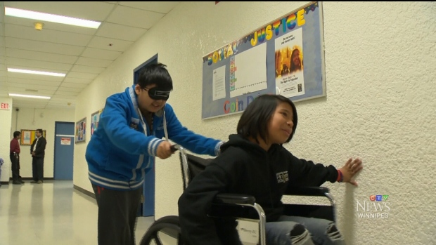 Students participating in the EC experience being in a wheelchair